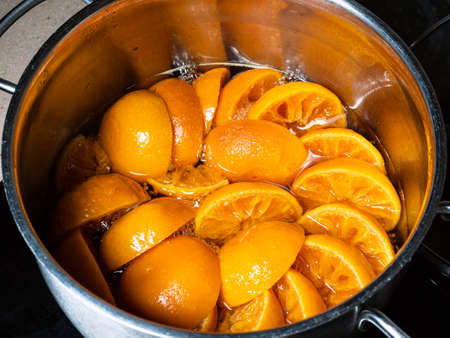 cooking of tangerine jam (varenye) in stewpot on hob at home kitchen