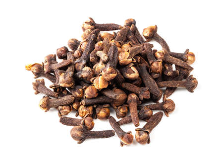 handful of dried cloves closeup on white background
