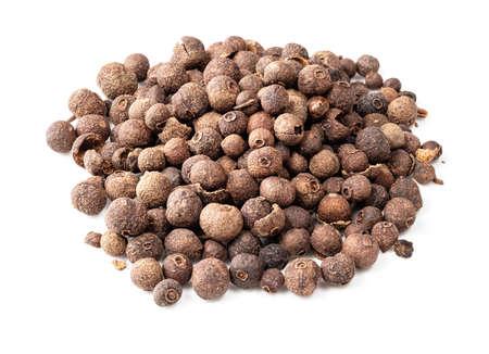 handful of allspice (jamaica pepper) closeup on white background