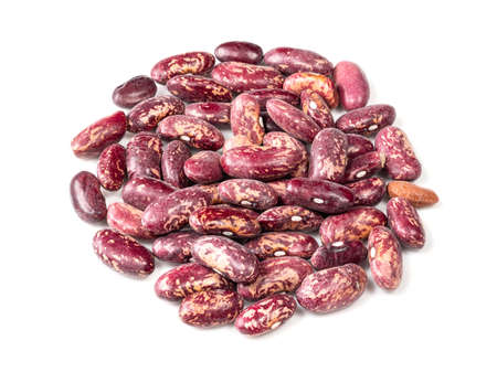 handful of red spotted pinto beans closeup on white background