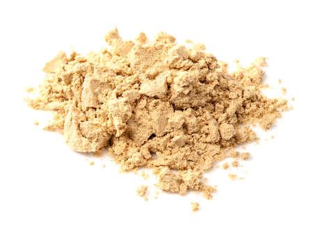 pile of ginger powder closeup on white background Foto de archivo