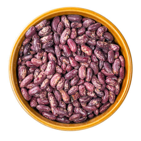 top view of red spotted pinto beans in round bowl cutout on white background Foto de archivo