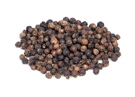 handful of hainan black pepper closeup on white background