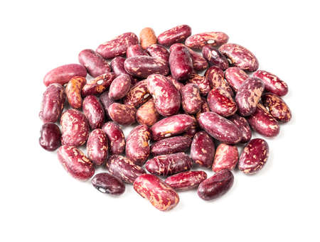 pile of red spotted pinto beans closeup on white background