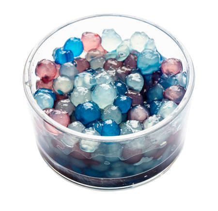 colorful boiled tapioca bubbles in glass bowl cutout on white background