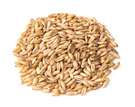 handful of wholegrain oat grains closeup on white background