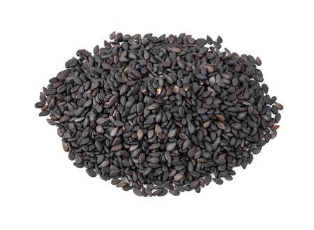 handful of black sesame seeds closeup on white background