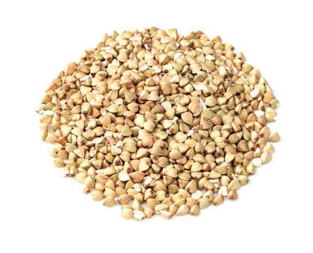 pile of green buckwheat grains closeup on white background