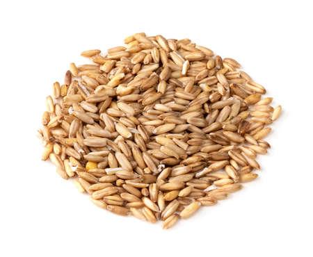 pile of wholegrain oat grains closeup on white background Stock fotó