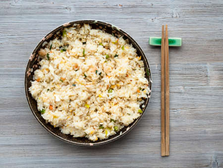 chinese cuisine - top view of yangzhou fried rice in ceramic plate on wooden table Stock fotó