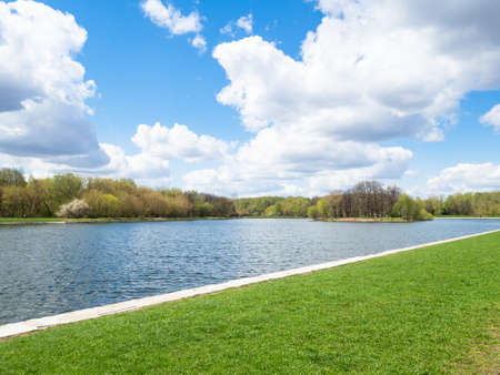 green lawn on waterfront of pond in Kuskovo garden in Moscow city on sunny spring day Stock fotó