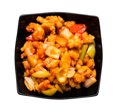 chinese cuisine - top view of Pineapple Fried Chicken in black bowl cutout on white background