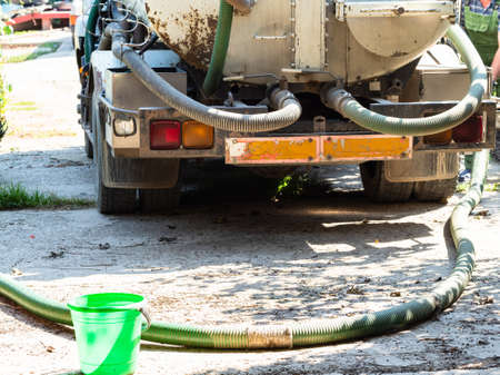 cesspool emptying machine in yard of country house in village