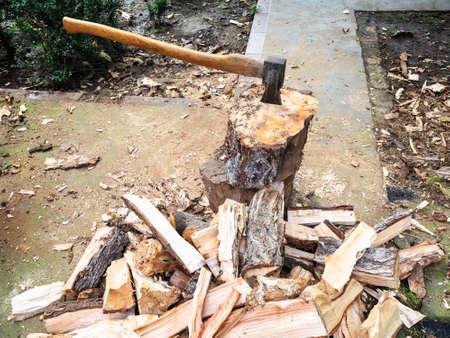 pile of chopped firewood on concrete path in backyard in village Stok Fotoğraf