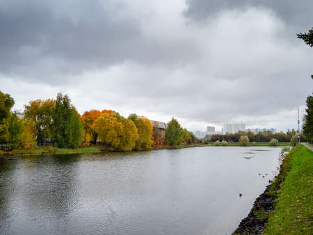 picturesque pond in Moscow city on overcast september day