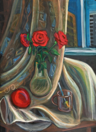 Three red roses in a glass vase photo