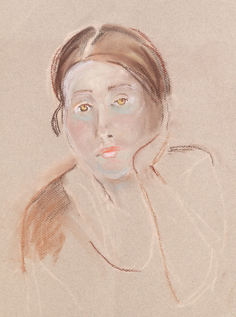 Portrait of the young woman. She is sitting and waiting