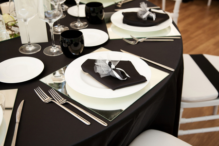 table set: Table set of black for wedding in Rome in Italy Stock Photo