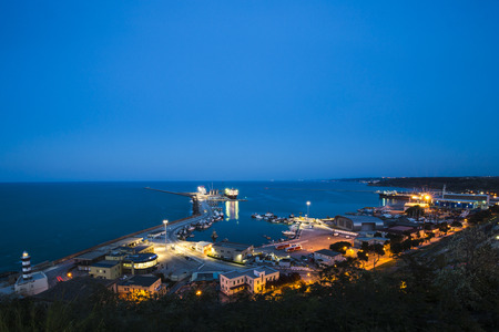 The Trabocchi coast. Night landscape of Ortona harbor in Abruzzo, Italy.