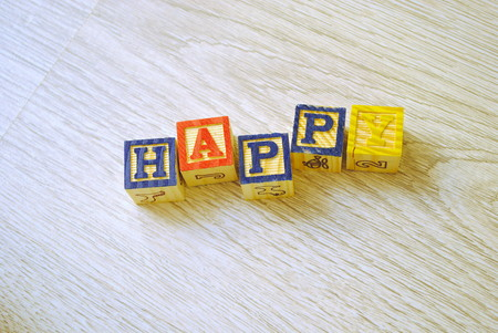 hapiness: Wooden blocks for children learning to write Stock Photo