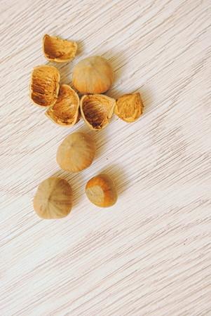 filbert nut: hazelnuts on a wooden background Stock Photo