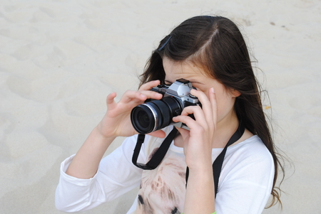 creating: Photographer while creating outdoor photographs