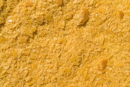 Organic Carnauba Wax come in the form of hard yellow flakes and is widely used in cosmetics as an emulsifier or as a thickening agent for lipstick, eyeliner, mascara, eye shadow, foundation, deodorant