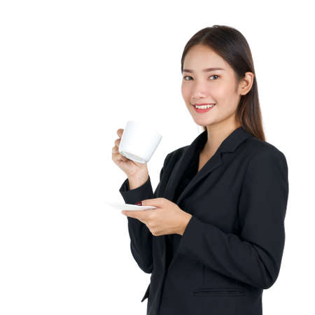 Young asian woman in black suit with a smile holding a cup of coffee. Portrait on white background with studio light. Close up