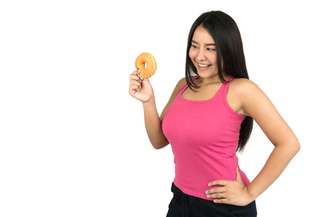 beautiful plus size Asian woman holding a doughnut, isolated on white background. 免版税图像