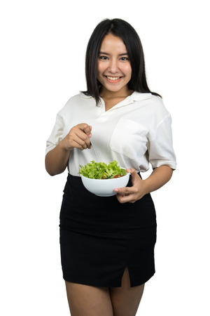 beautiful plus size Asian woman holding a bowl of salad, isolated on white background