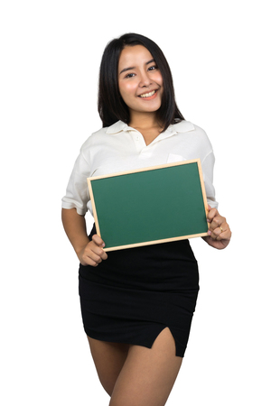 beautiful plus size Asian woman holding a small blank green chalkboard, isolated on white background.