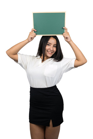 beautiful plus size Asian woman holding a small blank green chalkboard, isolated on white background. 免版税图像