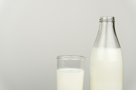 a glass of milk and milk bottle on white background Stock Photo