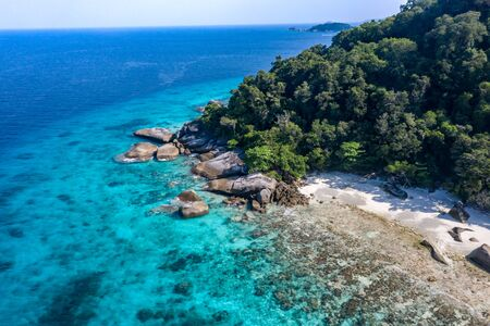 Aerial view on beautiful tropical island with white sand beach, turquoise water and granite stones. Similan Islands, Thailand.