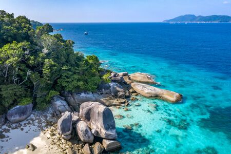 Aerial view on beautiful tropical island with white sand beach, turquoise water and granite stones. Similan Islands, Thailand. Stock Photo