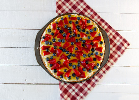 red plaid: Fruit Pizza on Red Plaid Napkin Stock Photo