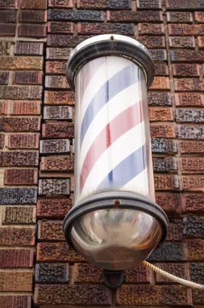 chrome man: Old Barber Pole on Brick Wall Stock Photo