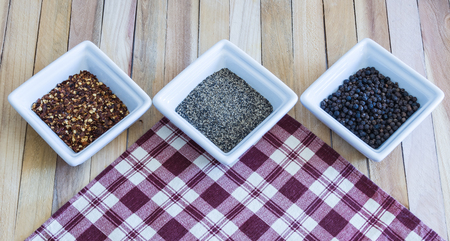 red plaid: Pepper Seasoning Variety on Red Plaid Napkin Stock Photo