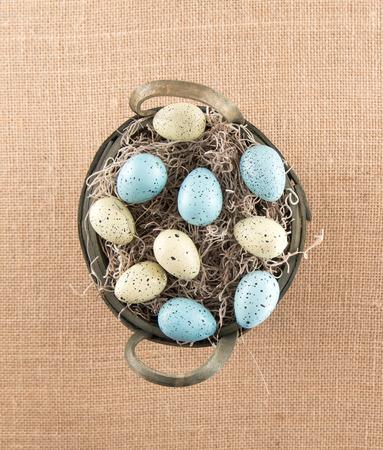 nestled: Speckled Eggs Nestled In Basket