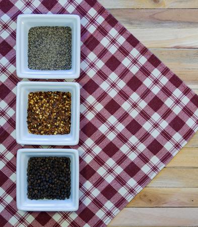 Pepper Varieties on Red Plaid Napkin 版權商用圖片
