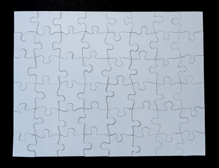 completed: Completed White Jigsaw Puzzle on Black Background