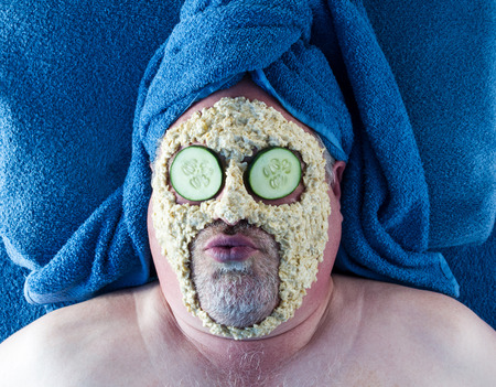 Man Getting Facial With Silly Facial Expression Stock Photo