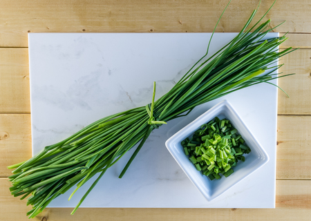 green herbs: Fresh Chives on White Marble