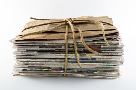 reading material: Newspaper Stack Tied With Twine