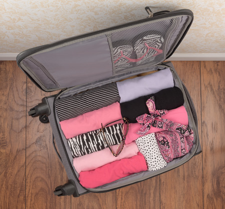 suitcase packing: Ladies Packed Carry On Suitcase Top Down Perspective