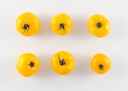 heirloom: Ripe Yellow Heirloom Tomatoes on White Background