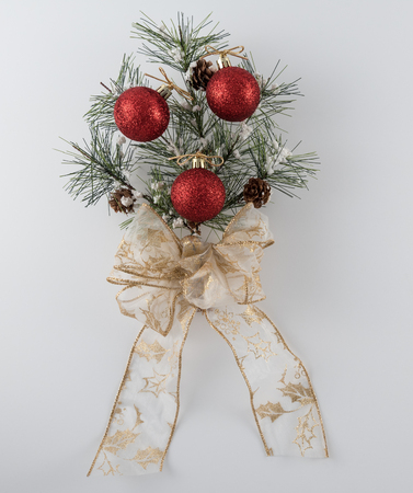 Pine Bough Decoration with Ornaments on White Background