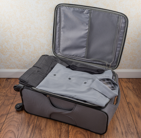 and carry on: Mens Packed Carry On Suitcase Stock Photo