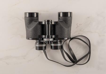 Vintage Binoculars on White Marble