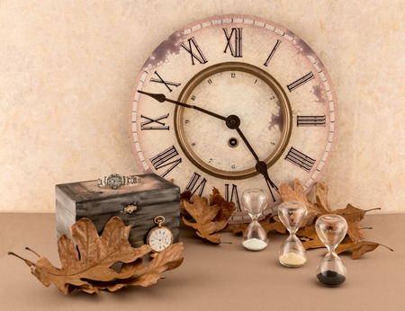 Wall Clock, Hourglass, Wristwatch and Pocketwatch with Autumn Leaves